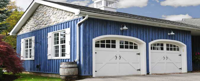 New generation of residential garage door styles add curb for Carriage style garage doors cost
