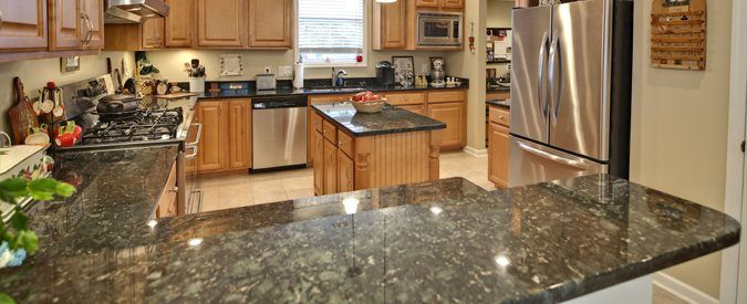 kitchen countertops vanity marble carrera bathroom cost countertop honed maple with white cabinets