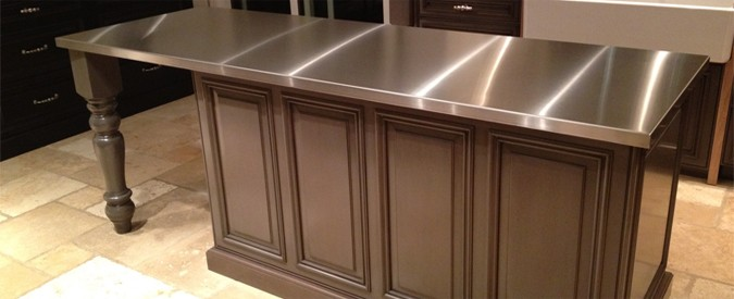 Stainless Steel Countertop On Brown Center Island